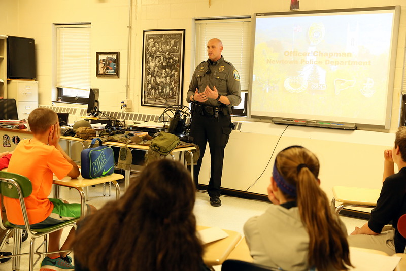 NMS SRO William Chapman spoke with his first group of students during one of three presentations for this year's Career Day. (Hallabeck photo)