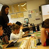 Middle Gate Elementary School fourth grade teacher Katie Mauro, standing left, interacted with her students on Wednesday, November 18, as she talked them through a trivia game she created inspired by International Education Week. (Hallabeck photo)