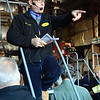 Auctioneer Sammy Petrowsky of Petrowsky Auctioneers, Inc of North Franklin, stands on a rolling stairway within a large shed at the JF Walsh Mulch & Logging Company site at 4 Toddy Hill Road in Sandy Hook on November 20, as he auctioned off the mulch firm's equipment to the highest bidders. (Gorosko photo)