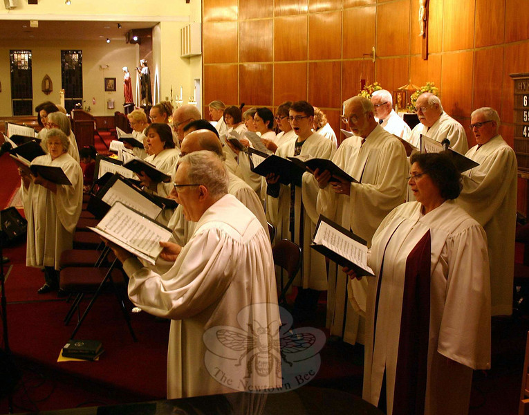 Thirty voices strong and directed by Joseph Jacovino, The Interfaith Choir rehearsed prior to Sunday evening's service. (Hicks photo)
