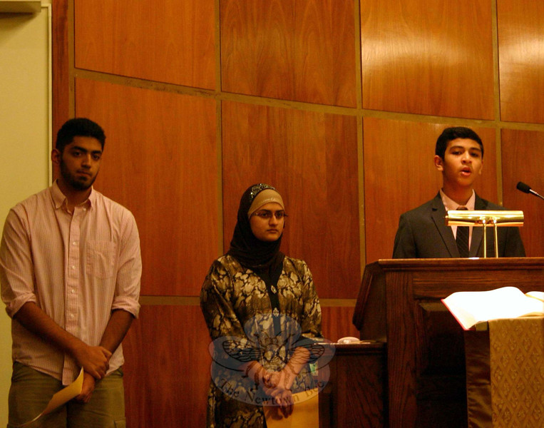 A reading and sharing from the Muslim faith was offered by, from left, Muhammad Sakhi, Mishwa Nawaz, and Muadh Bhavnagarwala. The hourlong interfaith event does not offer a formal sermon, but invites representatives from Newtown's faith communities to share readings and prayers, with musical interludes. (Hicks photo)