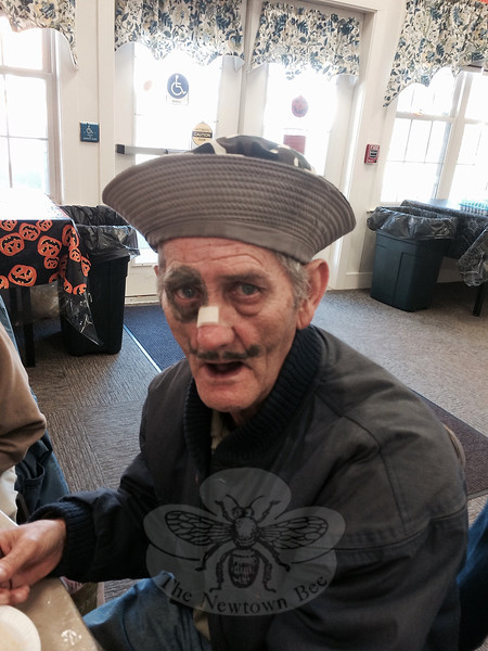 "Plenty of witches, a few cowgirls, a Viking, some classy gals, and a drunken sailor or two were among the more than four dozen Halloween revelers at the Nunnawauk Meadows Community Room, Friday, October 30. After a luncheon of sweet potato or split pea soup, meatloaf, and dessert, residents of Nunnawauk Meadows, members of Newtown Senior Center, and guests had fun with Halloween balloon volleyball and other games, and plenty of time to admire each other's creative costumes. ""What do you do with a drunken sailor?"" was the question put to Nunnawauk resident Al Cable, dressed as a rather battered seaman. (Crevier photo)"