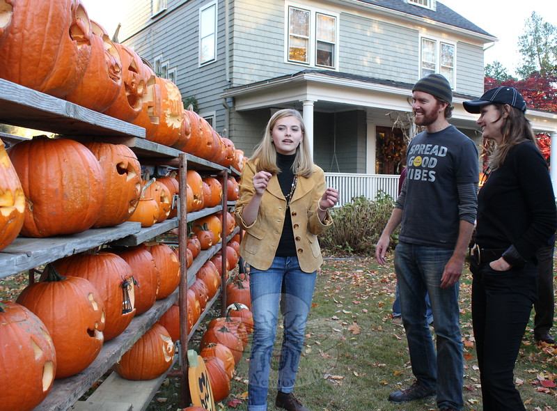 Mackenzie Page discusses some of the pumpkins on display Friday afternoon with Life is Good C0-Founder John Jacobs and actress Bridget Moynahan. (Hicks photo)