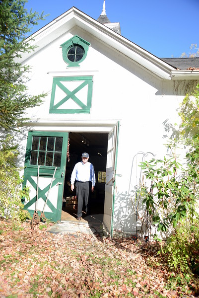 Resident George Miller stands in the doorway of his barn at 50 Main Street, where The Horticulture Club of Newtown is gathering items for its a tag sale on Saturday, November 14, from 9 am to 2 pm, rain or shine. Proceeds from the sale will support the 2016 Newtown Scholarship Fund.	(Bobowick photo)