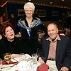 Members of the Newtown Country Club gathered at the club on the night of Friday, October 30, for the group's 100th anniversary gala. Among those attending the festive event were longtime members Joan Crick, standing, and Jini and Robert Woodies.  (Gorosko photo)