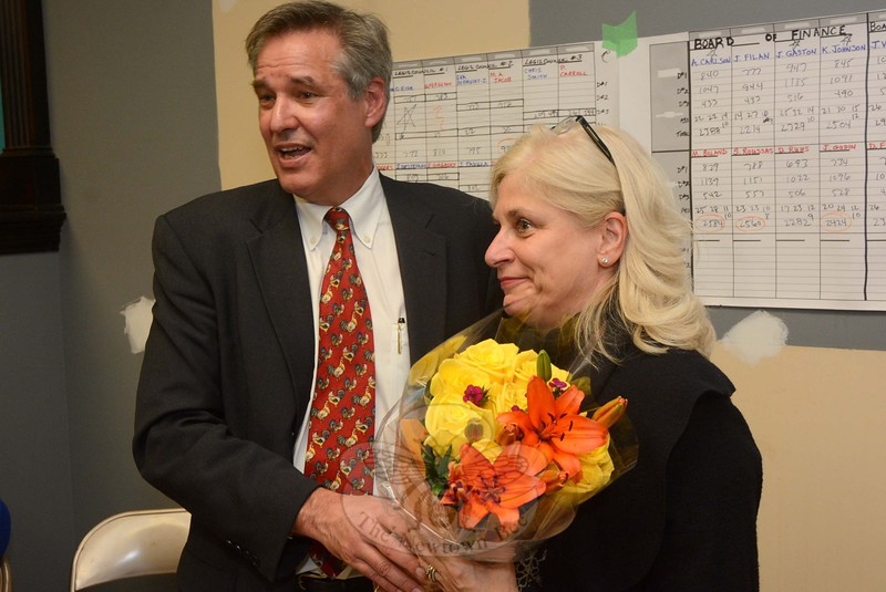 James Gaston presented a bouquet to Maureen Crick Owen in thanks for the work she had done in helping to organize the Democratic municipal election campaign. (Gorosko photo)