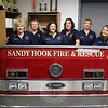 The Sandy Hook Fire & Rescue Company Ladies Auxiliary is looking for new members. To introduce themselves to the community, and to answer questions about their work, the auxiliary will host an open house on Tuesday, November 10, at 7 pm. After a brief business meeting, members will introduce themselves to guests and explain their role as a support group for the fire company. The auxiliary supports firefighters in the event of large fires and other community emergencies, including respite care by means of water, snacks, and meals when needed. The group does fundraising through annual Easter and Mother's Day flower sales, and participates in firehouse events. Auxiliary members do not need to have a relative in the fire company to join. Members need to be at least age 19, however. General membership meetings are the second Tuesday of each month at 7 pm. The open house will be at the Sandy Hook Fire & Rescue main station, at 18-20 Riverside Road. Light refreshments will be served. From left are some of the auxiliary's current members, Joyce Staudinger, Janice Butler, Debbie Aurelia Halstead, Laurie Comerford, Christine O'Grady, and Donna Liska; Ms Comerford is president of the auxiliary. Reservations are not necessary, but additional information is available from Ms Comerford at 203-948-4804. (Hicks photo)