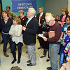 Local Democrats gathered at Democratic Headquarters at Newtown Shopping Village on Tuesday night to review election results in the municipal elections. Eric Paradis, extreme left, posted the results on several boards as Democrats watched to learn how their party had performed in the elections. (Gorosko photo)