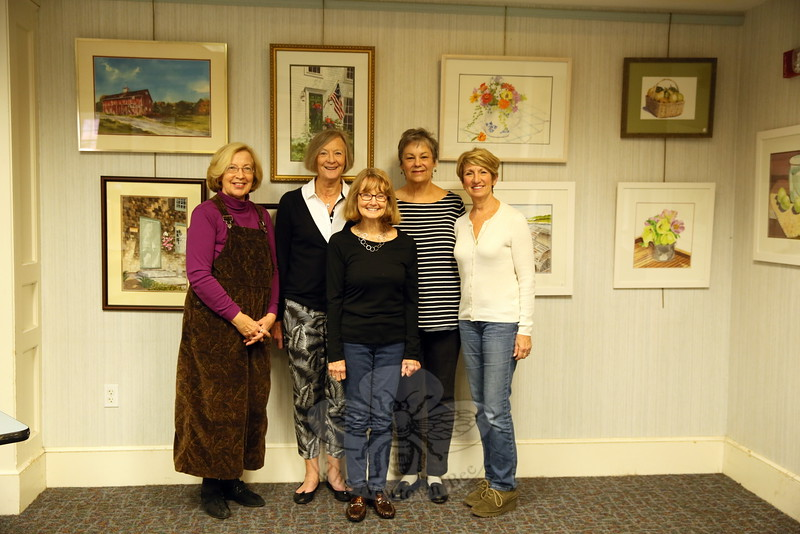 From left is Liz Arneth, Maureen Rohmer, Robyn Dohrenwend, Marianne Zelno, and Claudia Mitchell, who gathered at C. H. Booth Library on Monday, November 2, the day after an exhibition was put on view in the library's meeting room. (Hallabeck photo)