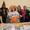 Staff members at the town clerk's office donated a carved pumpkin to the charitable 2015 Great Pumpkin Challenge campaign, which was spearheaded by Mackenzie Page on Main Street. From left, are Town Clerk Debbie Aurelia Halstead, and Assistant Town Clerks Aileen Barreto, Renee Weimann, and Monica Duhancik.  (Gorosko photo)