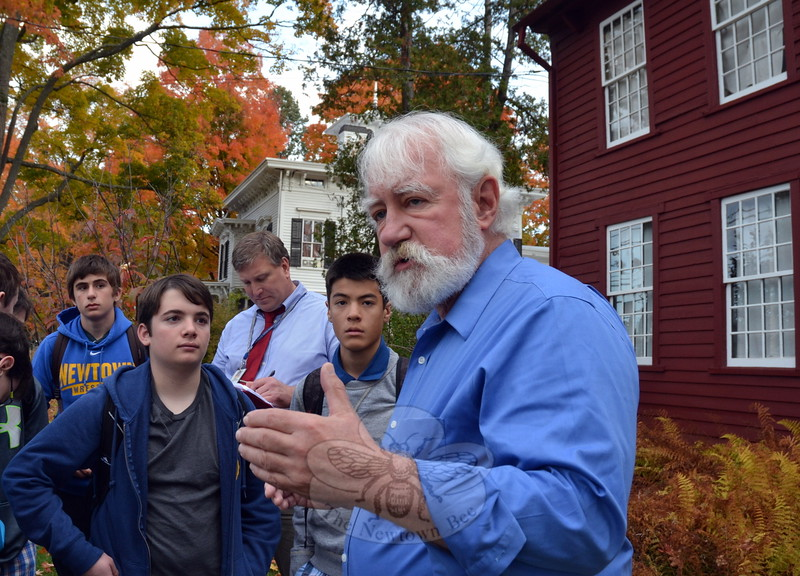 Town Historian Dan Cruson, right, led a group of Newtown High School architectural design students for a tour of Main Street on Thursday, October 22. (Hallabeck photo)