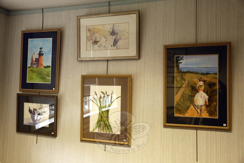 "A look at some of the works displayed in the library's meeting room for the ""Here's To Painting… Encore"" exhibition. (Hallabeck photo)"