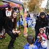 Cassandra David wore great black wings and horns as she offered treats outside Dr Baum Orthodontics' booth on October 31 for Halloween festivities on Main Street. (Bobowick photo)