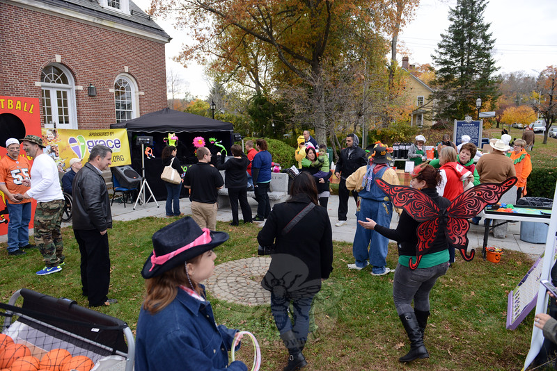 A crowd gathered for games and refreshments sponsored by Grace Family Church on October 31 for Halloween festivities on Main Street. (Bobowick photo)