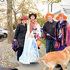 Sue and Terry Jackson with daughters Ava and Brooke. With them were Linda and Richard Mitchel and their golden retriever, all ready for the annual Halloween fun on Main Street. (Bobowick photo)