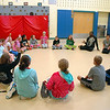 Pilobolus teaching artist Nile Russel was surrounded by Reed Intermediate School students at the start of a lesson on Thursday, October 2. (Hallabeck photo)