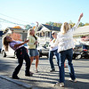 Dancing with abandon while One Level Down played rock and roll on the sidewalk in front of Sandy Hook Hair Co, friends, from left, Kathy Holick, also known as Newtown's dancing traffic agent, Passport Event Chair Maribeth Hemingway, Heidrun Morgan, and Ingrid Bergquist laugh as the music plays.(Bobowick photo)