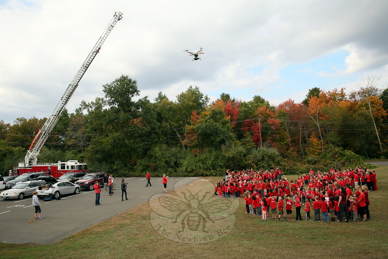"A Newtown Hook & Ladder Co. #1 ladder truck, and two drones, like the one pictured, were used to take photos and video on Thursday, October 8, of the Middle Gate School community gathering to form the words ""Be Kind"" and the shape of a heart.  (Hallabeck photo)"