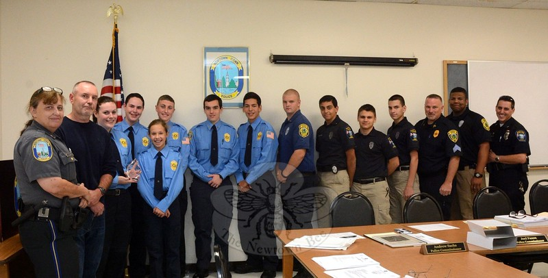 Police cadets from Newtown, Easton, and Fairfield gathered at an October 6 Newtown Police Commission meeting to receive formal recognition from the commission for their public service work. Some of the police cadets from those three towns are pictured with their police advisors. The cadets are a youth organization through which members learn about police work and also aid police, as needed, at incidents and events. (Gorosko photo)