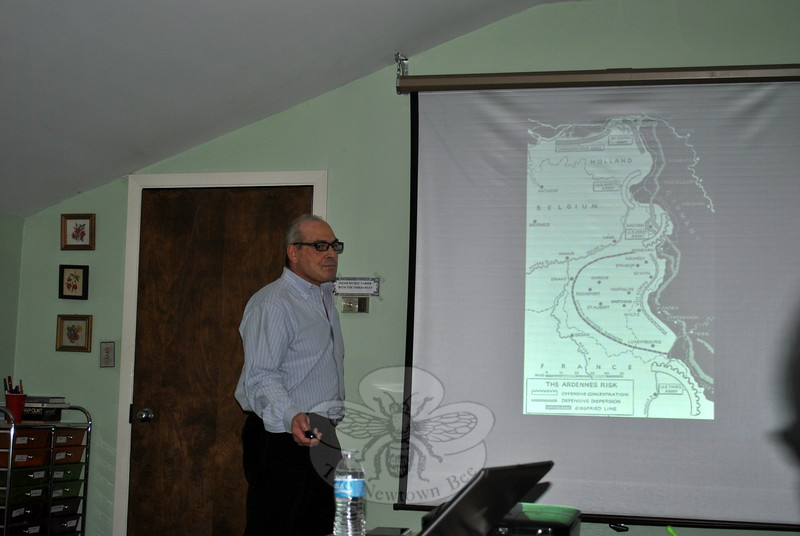 Historian Arthur Gottlieb uses maps and photographs to tell the story of the Battle of the Bulge, Thursday, October 8, one of an ongoing series of history presentations at the Newtown Senior Center. (Crevier photo)