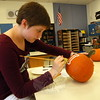 NMS art enrichment student Meredith Taylor painted a bone on her pumpkin, which will be among others on display at the Great Pumpkin Race this Saturday, October 17.  (Hallabeck photo)
