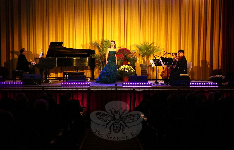 Soprano Krista Adams Santilli of Trumbull sang on the stage at Edmond Town Hall during the Kevin's Community Center Mozart, Merlot and Mums fundraiser on Saturday, October 10.  (Hallabeck photo)