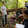 Reed teacher Todd Stentiford spoke to a group of his students by Deep Brook on Thursday, October 8, during a GM Green project. (Hallabeck photo)