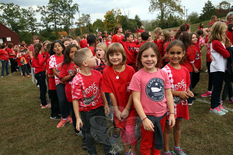 Middle Gate Elementary School students Julia Wologodzeu, front second from left, Mary Guion, front center, and Ashley Jackson, front right, stood together before the final aerial photo was taken. (Hallabeck photo)