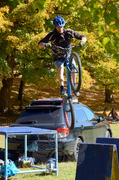 Stunt cyclist Joe Janicki from New Haven thrilled festivalgoers at the 2015 Shuck 'N Jive festival that ran throughout the weekend of October 9-11 at McLaughlin Vineyards. Organizers say hundreds of visitors showed up each day to enjoy music by more than 20 musical acts, along with a challenging off road bicycle race, vendors, and the beautiful early autumn scenery that was enhanced by clear, dry weather once a quick-moving storm cleared the area late Friday afternoon. (Voket photo)