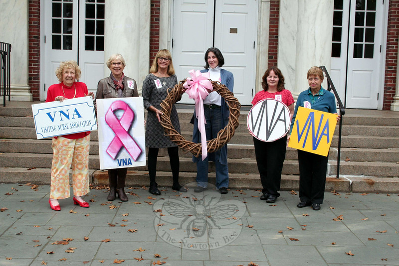 The American Cancer Society says about one in eight — or 12 percent — women in the United States will develop invasive breast cancer during their lifetime. Members of Newtown VNA gathered in the courtyard of Edmond Town Hall on October 14, with the wreath that will be hung from the building at 45 Main Street. Adorned with pink ribbons, the wreath will remain in place through the remainder of October in honor of Breast Cancer Awareness Month. From left is Mae Schmidle, Margareta Kotch, Mary Tietjen, Alice Falkowitz, Donna Culbert, and Terry Merola.	(Hicks photo)
