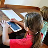 Jillian Hoag, left, and Kelsey Brennan practiced writing lessons on slates as part of the activities on Sunday, September 20, at the Little Red Schoolhouse. (Hallabeck photo)