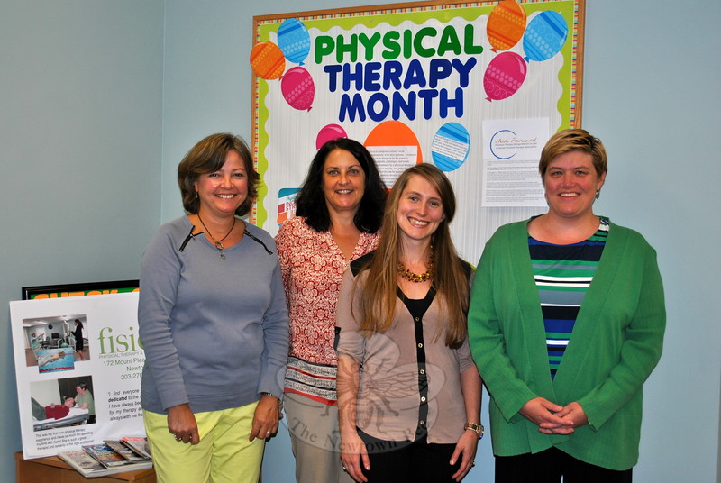 From left, fisio receptionist Judy Fredette, office manager Alice DiLuoffo, and physical therapists Ashley Witson and Karen LaBanca work to create a welcoming environment, especially for older clients. (Crevier photo)