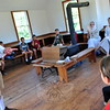 Newtown Historical Society docent Mike Asselta, left, was the school master on Sunday, September 20, when the society hosted lessons and period recess activities at the Little Red Schoolhouse. (Hallabeck photo)