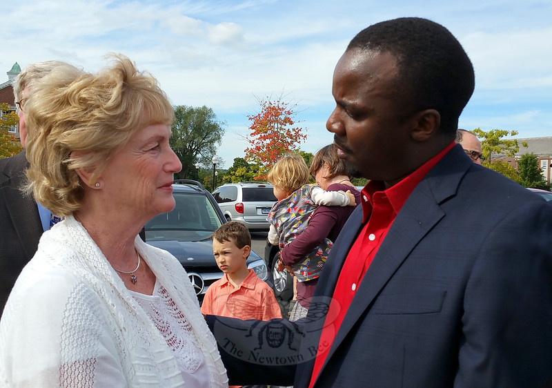 """Former governor M. Jodi Rell is greeted by Julia Wasserman's """"African son"""" Musa Lubega during a celebration of remembrance for the late Newtowner and longtime state representative. (Voket photo)"""