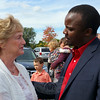 "Former governor M. Jodi Rell is greeted by Julia Wasserman's ""African son"" Musa Lubega during a celebration of remembrance for the late Newtowner and longtime state representative. (Voket photo)"