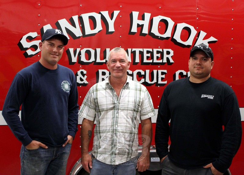 The co-chairs of the first Sandy Hook Volunteer Fire & Rescue Bourbon Tasting & Food Pairing event are, from left, Ryan Clark, Michael Burton, and Matt Dobson. Four courses of catered food will be paired with complementary bourbons during the new fundraiser, being planned for Saturday, October 24, at the company's main station on Riverside Road.                                                                       (Hicks photo)