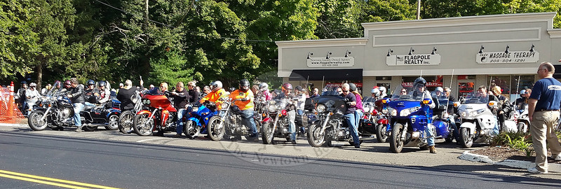 "Before more than 100 riders thundered out of Ricky's Plaza for the 6th Annual Firehouse Ride to benefit Newtown Hook & Ladder, everyone in the normally boisterous crowd fell silent as Monsignor Robert Weiss — ""Father Bob"" — from St Rose of Lima issued a blessing to help inspire and protect participants during the 50-mile tour through the region Sunday, September 27. The event concluded with most of the participants and many other local residents and supporters turning out for a barbecue, raffles, and live music that continued for much of the rest of the day. (Voket photo)"