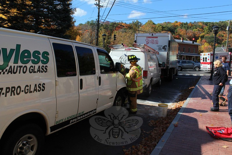 Police report that a chain-reaction accident involving three commercial vehicles occurred about 1:50 pm on October 15 on Washington Avenue just south of its intersection with Riverside Road, Glen Road, and Church Hill Road. Police said that that trucker Thomas Kapustynski, 61, of Ansonia, who was driving a 2016 Hino box truck (far right), was waiting at a red traffic signal. Terrence Richardson, 44, of Brooklyn, N.Y., who was driving a 2012 Ford van (center), was waiting behind the Hino, police said. William DeJesus, 38, of South Windsor, who was driving a 2011 Chevrolet van (foreground), then struck the rear end of the Ford, pushing the Ford into the rear end of the Hino, police said. Newtown Volunteer Ambulance Corps evaluated DeJesus at the scene, police said. Sandy Hook volunteer firefighters responded to the accident. Police said they issued DeJesus an infraction for failure to drive a reasonable distance apart. (Hicks photo)