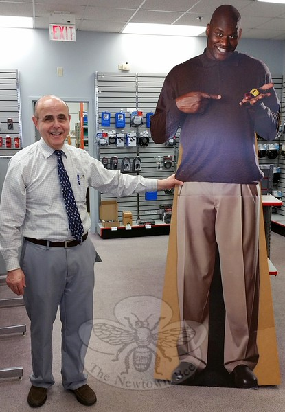 Hugh Goldberg got such a kick out of this mini radio controlled car promotion featuring basketball star Shaquille O'Neal that he decided to keep it as one of the few mementos he and his wife and Radio Shack store owner Sue will take along when they close the store October 24. (Voket photo)