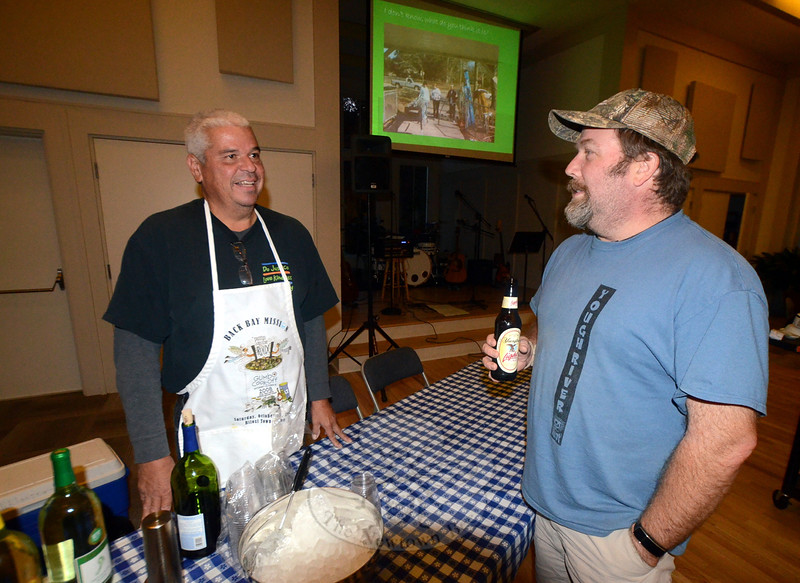 Jerry Cole serves up beverages and conversation with Newtown Congregational Church parishioner and Newtown High School teacher Trent Harrison during the Low County Shrimp Boil on October 17. (Voket photo)