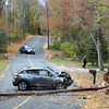 Police report that at about 12:23 pm on October 18, motorist Christopher Rosini, 28, of Brookfield was driving a 2013 Nissan Juke SUV on Old Hawleyville Road, near its intersection with Farrell Road, when the vehicle struck a utility pole, bringing it to the ground. Newtown Volunteer Ambulance Corps transported Rosini, seen at right being checked by Hawleyville firefighters, to Danbury Hospital for treatment of injuries, police said. The accident, which closed the road until Eversource could clear the pole and wires, is under investigation, according to police. (Hicks photo)
