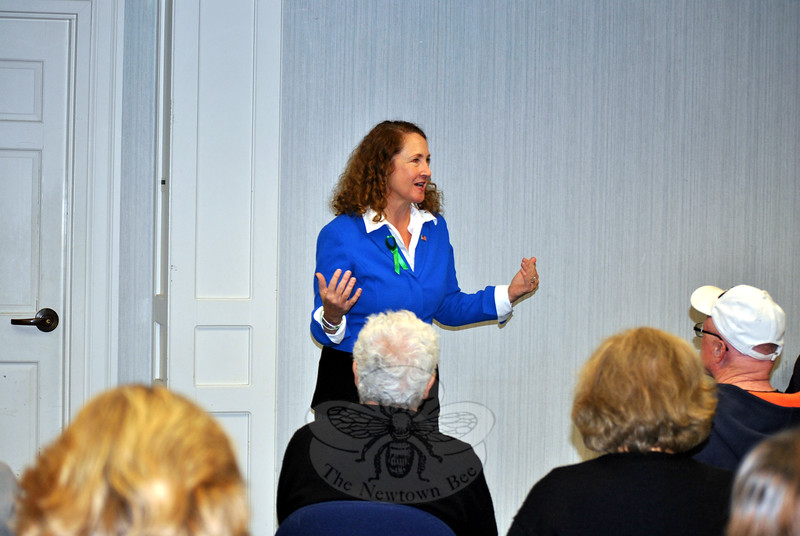 """Elizabeth Esty, US Representative for the Fifth District of Connecticut, addresses a crowd a C.H. Booth Library, Monday afternoon, October 19. Rep Esty was in Newtown for a """"Congress On Your Corner"""" venue, the ninth one-on-one meeting with constituents she has hosted in the state. More than three dozen people signed up for a brief, personal meeting with the congresswoman, taking advantage of the opportunity to express concerns, and pick up state and federal informational material. (Crevier photo)"""