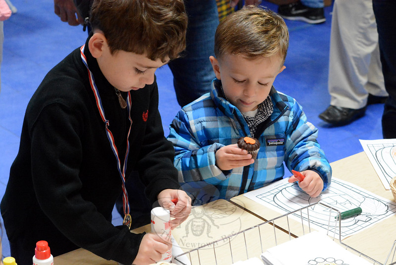 Logan Kistner, 5, and Peyton Manca, 2, get creative, although Peyton is a bit distracted by his cupcake. (Hutchison photo)