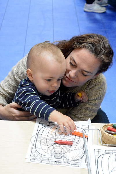 Leah Newman draws with her 16-month-old, Ellis, at the Fraser Woods Montessori Fall Family Festival on October 17. (Hutchison photo)