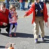 Andrew Hoyack, 8, tests his skills in the pumpkin ring toss event as sister Claire, 4, and mom, Karen Hoyack, watch. (Hutchison photo)