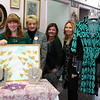 Retail (For) Therapy will be a mini vendor fair at Julie Allen Bridals that will offer attendees the chance to enjoy an evening out while fundraising for Newtown Lions Club's Sandy Hook Elementary Fund. From left is Lauren Morehouse, Melanie Mattegat, MaryAnn Cyr-Suarez and Liz Brestovansky. Mrs Morehouse is a consultant for the jewelry company Chloe + Isabel, Mrs Mattegat is the owner of the bridal salon, Mrs Cyr-Suarez is a consultant for Jamberry, and Mrs Brestovansky is a consultant for the clothing company Kokoon. Mrs Morehouse is holding a painting that will be offered through silent auction.	(Hicks photo)