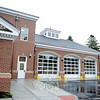 A six-bay garage for the new Newtown Volunteer Ambulance Corps headquarters is set up as a pass-through, with three bay doors in front and three in back. This back view connects to common parking areas on the Fairfield Hills campus. A series of opening celebrations will be hosted by Newtown Volunteer Ambulance this month, including a public open house on Sunday, October 19. (Bobowick photo)