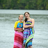 Friends and first-time water skiers Fallyn Kurlin, left, and Elise Johnson dry off in beach towels after a run across the water at Eichler's Cove Marina. (Bobowick photo)
