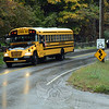 A school bus travels on Fan Hill Road in Monroe Wednesday afternoon, taking Sandy Hook Elementary School students home after a threat was called in to the school. The incident is being investigated. (Gorosko photo)