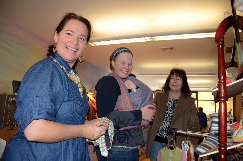 Vendor Vineta Abele got to show off her handiwork to three generations of the Settanni family — infant daughter Amalia, mother Sarah and mother-in-law Marleen, at the the Waldorf Fall Fair & Craft Market at the Housatonic Valley Waldorf School in Dodgingtown. (Voket photo)
